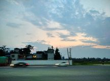 Speeding car and evening royalty free stock images