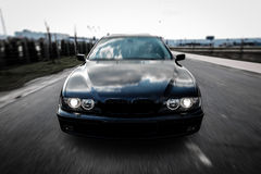 Speeding car. Front face shot, rigshot style Stock Images