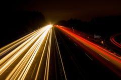 Speeding Car on High Way during Night Time Royalty Free Stock Image
