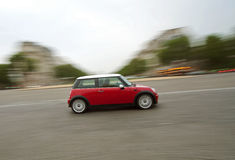 Speeding car (Mini Cooper) Royalty Free Stock Photo