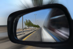 speeding car mirror stock photo