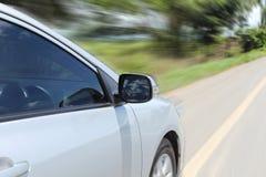 Speeding car with motion blur. Background Stock Photos