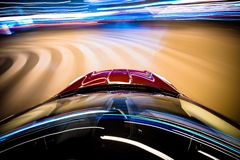 Speeding Car. Car in Motion. Blurred City Lights on Curved Road. Long Exposure Car Driving Photo Stock Photo