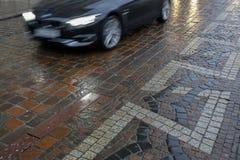 Speeding car during rain. Speeding black car during rain Stock Photography
