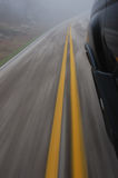 Speeding car road blur. Road blurred due to car speeding on a winding country road Stock Photo