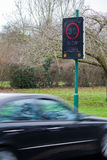 Speeding car and speed camera Stock Photos
