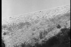 Speeding car veering off road and falling off cliff, 1930s stock video footage