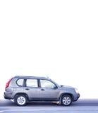 Speeding Car On White. Speeding Family Car Isolated on White Background Royalty Free Stock Image