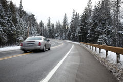 Speeding car on a winter road Royalty Free Stock Photos