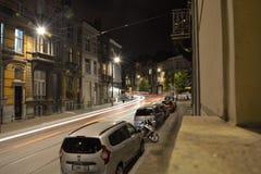 Speeding carlights at night Stock Photo