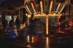 Speeding carousel in the night Royalty Free Stock Images