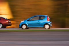 Speeding cars Stock Photography