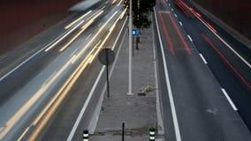 Speeding cars around medium. Video of speeding cars around medium stock footage