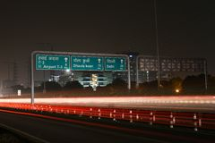 Speeding cars on modern Road infrastructure in Gurgaon, Delhi, India.Artistic long exposure shot at night Stock Image
