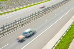 Speeding cars on motorway Royalty Free Stock Photos