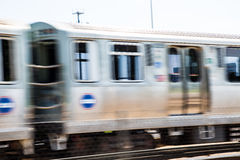 Speeding Commuter Train. A speeding commuter train in Chicago royalty free stock photo