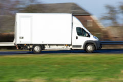 Speeding delivery van. White delivery van on a highway in Holland royalty free stock images