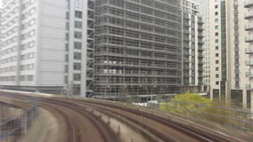Speeding DLR train entering Canary Wharf stock footage