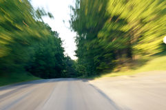 Speeding. Driving fast down a country road.  Image is intended to show how the road ahead looks from the viewpoint of a driver who is speeding or a passenger Stock Image