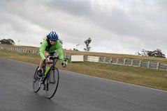 Speeding female cyclist Royalty Free Stock Photography