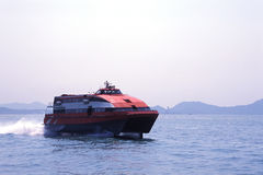Speeding Ferry. A red ferry speeding on the sea Stock Photos