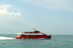 Speeding ferry. A ferry speeds on calm sea Stock Photography
