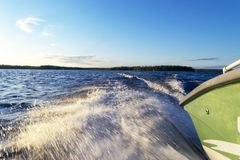 Speeding fishing motor boat with drops of water. Blue ocean sea water wave reflections with fast fishing yacht. Motor boat in the. Blue ocean. Ocean yacht stock photos