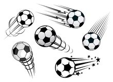 Speeding footballs or soccer balls Stock Photo