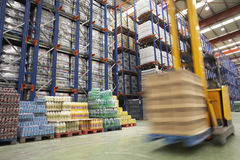 Speeding Forklift In Warehouse Stock Photography