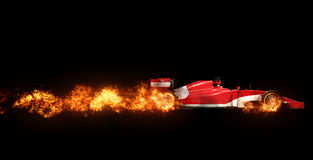 Speeding Formula one car - wheels on fire. On black background Stock Photos