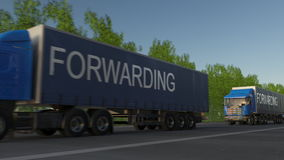 Speeding freight semi truck with FORWARDING caption on the trailer. Road cargo transportation. 3D rendering Stock Photos