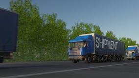 Speeding freight semi trucks with SHIPMENT caption on the trailer. Road cargo transportation. Seamless loop 4K clip stock footage