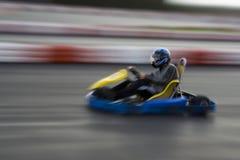 Speeding Go Kart. Youth riding go kart on race track Royalty Free Stock Photo