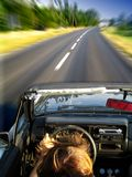 Speeding in Golf cabrio Royalty Free Stock Photography