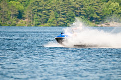 Speeding jet ski Stock Photo