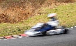 Speeding kart stock photo