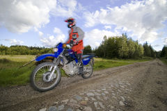 Speeding motorbike Stock Photography