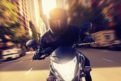 Speeding Motorbike. In the city Royalty Free Stock Photography