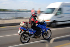 SPEEDING MOTORCYCLE. A speeding motorcycle with intentional camera motion blur Royalty Free Stock Photos