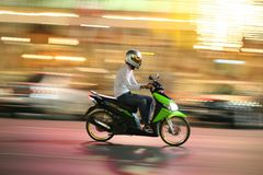 Speeding motorcycle. Speedong Motorcycle with blurred backgroung to generate movement Stock Photo