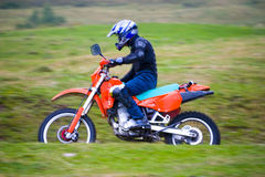 Speeding motorcycle Stock Image