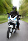 Speeding Motorcyclist Royalty Free Stock Images