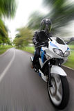 Speeding Motorcyclist Stock Photo