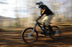 Speeding mountain biker. Blurred Royalty Free Stock Photo