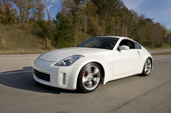 Speeding Nissan 350Z stock images