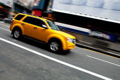 Speeding NYC Taxi SUV Royalty Free Stock Photography