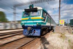 Speeding passenger train. Leaving the platform Royalty Free Stock Photo