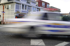 SPEEDING POLICE CAR. MOTION BLUR. Police car on the move Royalty Free Stock Images