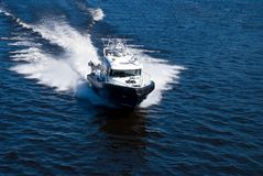 Speeding power boat. Aerial view of a speeding power boat Royalty Free Stock Image