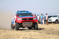 Speeding red and blue Toyota Hilux twin cab rally car front view Royalty Free Stock Photo